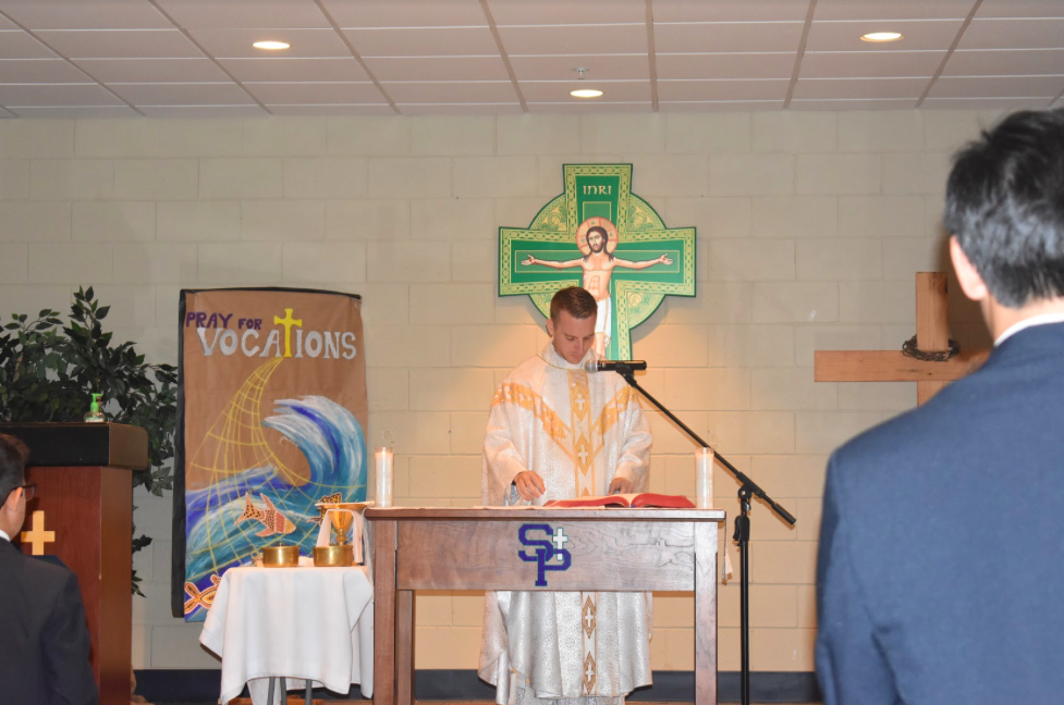 Father Colten Symmes celebrates Mass on Thursday, August 23