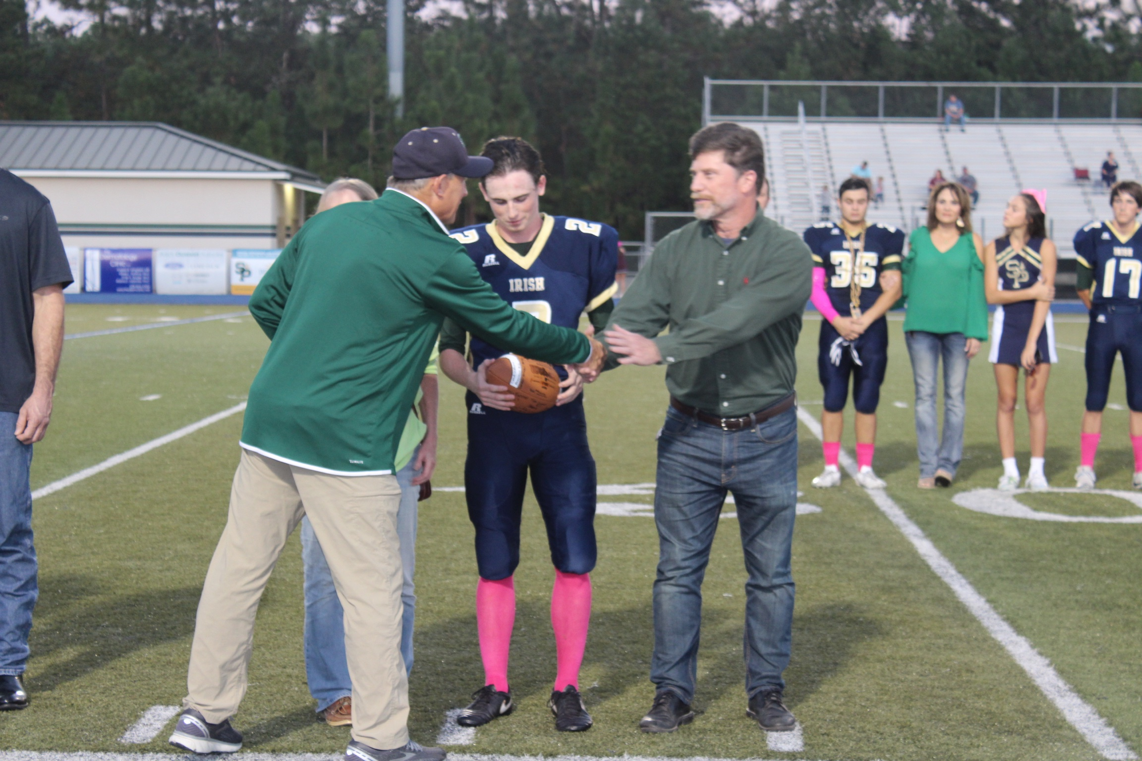 Class of 2019 fall athletes and band members are celebrated during final home football game of season