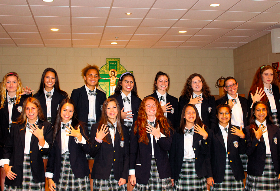 Father Charles Nutter celebrates 2018 Girls Track & Field Championship Ring Mass on October 18
