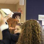 Seniors proudly displaying their bibles