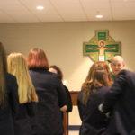 Choir and seniors receiving the Eucharist_