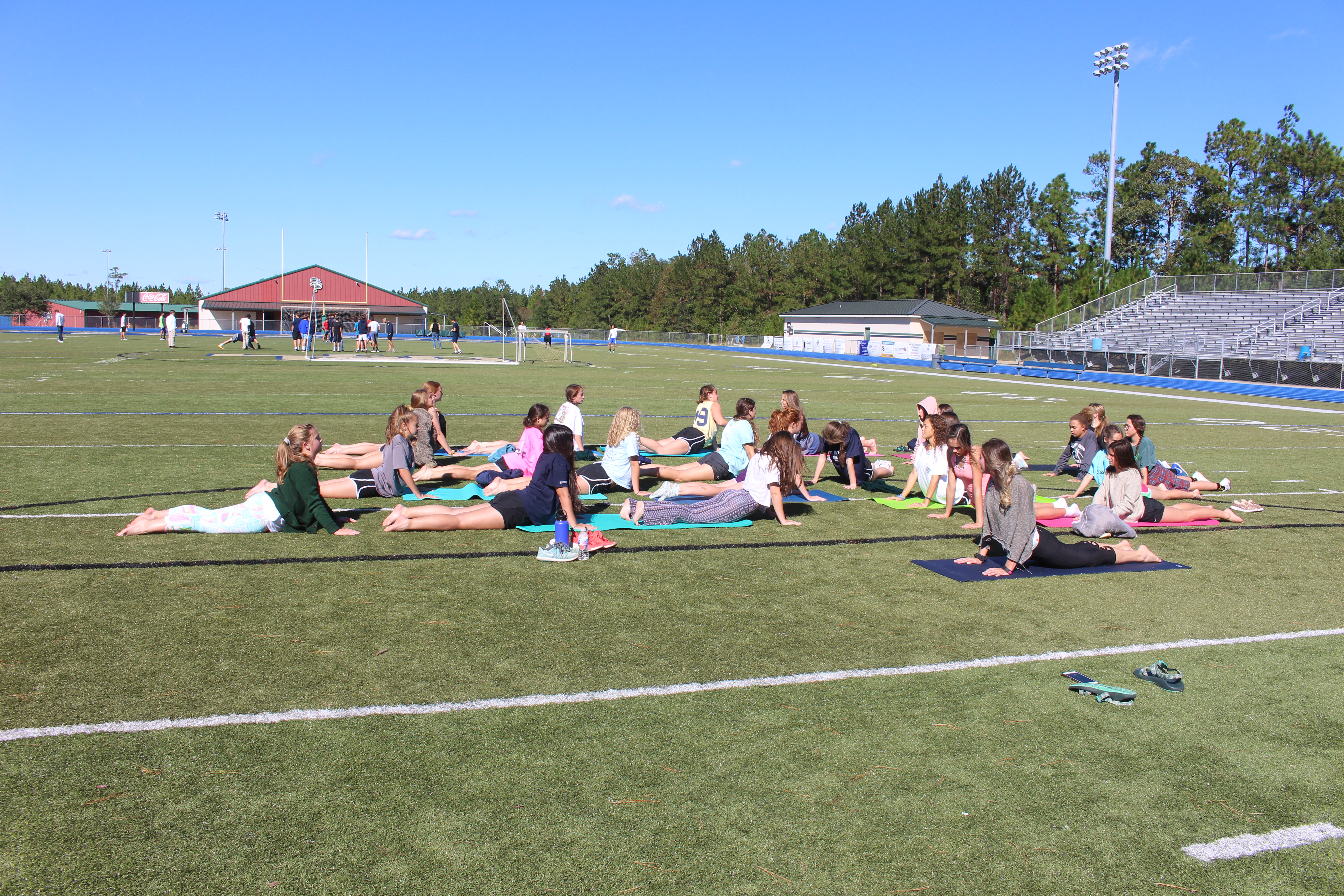 Girls soccer team enjoys yoga for active recovery