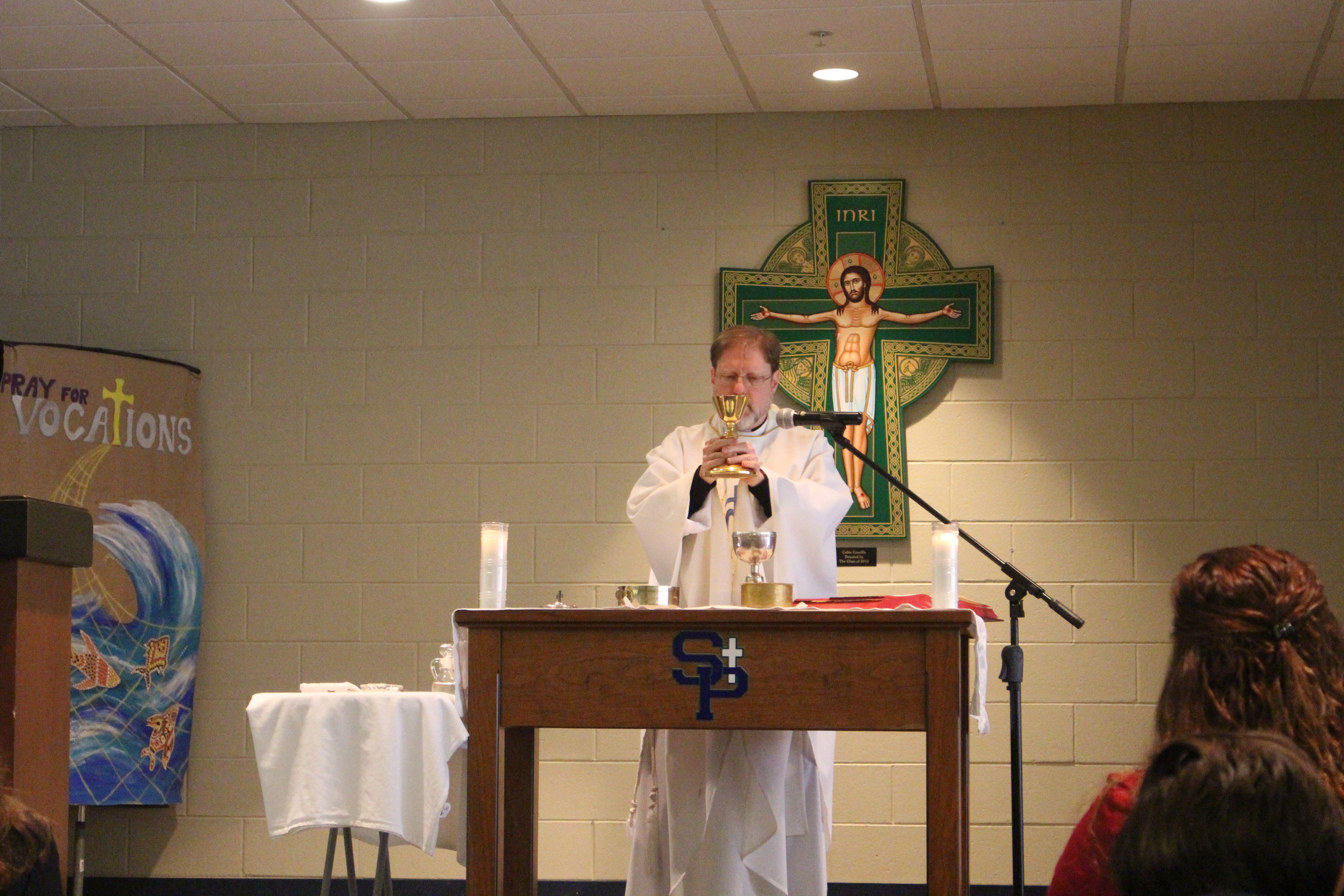 Father Mike Snyder from St. Alphonsus Parish celebrates school-wide Mass