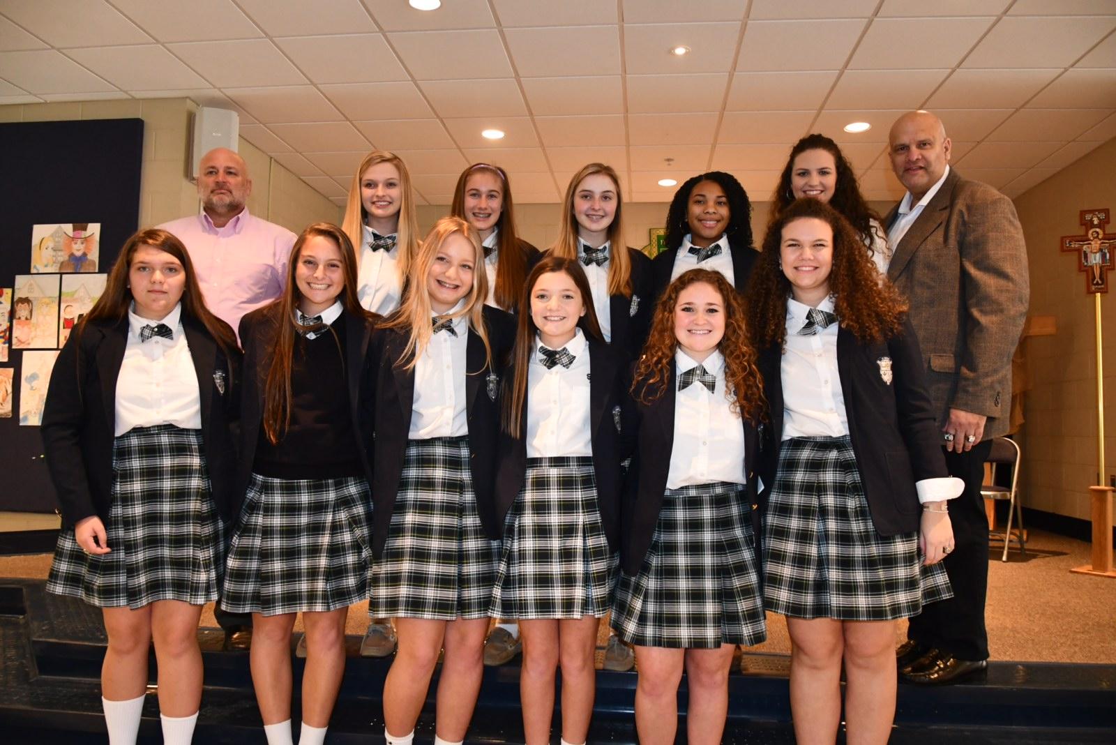 Father Charles blesses Lady Irish Varsity Softball Team championship rings